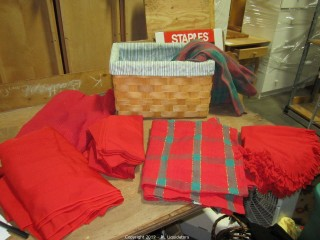 Basket full of tablecloths and napkins
