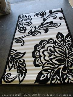 Capri collection black and white area rug