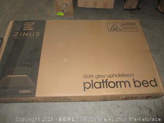 dark grey upholstered platform bed