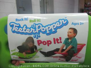 teeter popper children's toy