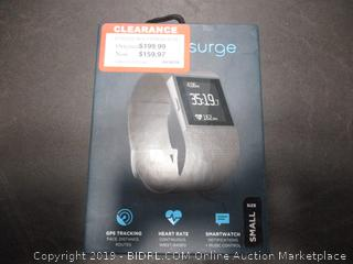 FITBIT SURGE FITNESS SUPER WATCH (POWERS ON)