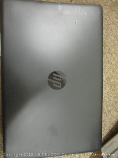 HP Laptop (Damaged, Powers On)