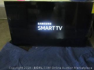 "Samsung flat 58"" smart TV - powers on"