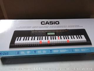Casio keyboard with stand/headphones-box damaged (online $169)