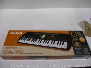 Casio Keyboard with headphones