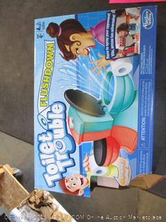Toilet Trouble Flushdown Game