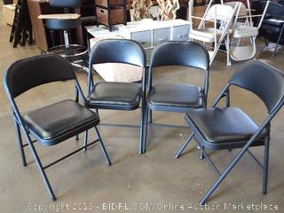 4 black metal folding chairs