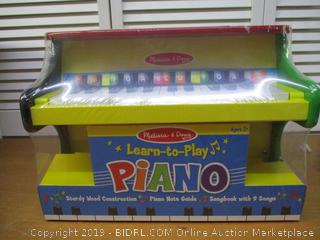 Melissa & Doug Learn-to-Play Piano, Solid Wood Construction, 25 Keys and 2 Full Octaves, 11.5 H x 9.5 W x 16 L,