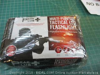 Multi Purpose Tactical LED Flashlight factory sealed