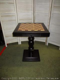 Chess board table with storage drawer for pieces.