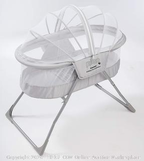 Primo cocoon folding travel bassinet (online $64)