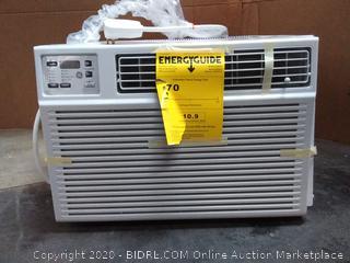 GE heat/cool room air conditioner (powers on) (broken corner)