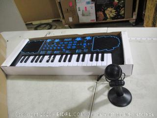 First Act - Portable Keyboard With Microphone