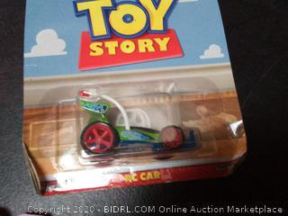 Hot wheels Premium Disney Pixar Toy Story car plus even after night bobble head toy