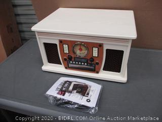 victrola 8 in 1 Turntable  powers on in box