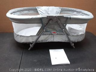 Primo cocoon folding travel bassinet