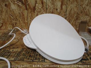 KOHLER Electric Bidet Toilet Seat, Touchscreen Remote Control, Heated seat, Automatic Deodorization and Nightlight, K-4108-0, White ($974 Retail)