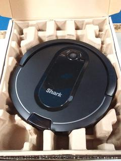 Shark IQ Robot Vacuum with Self-Empty Base and Wi-Fi Home Mapping, with XL Capacity Dust Bin, in Black (online $449) powers on