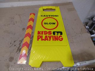 Caution ids Playing Stand Up Sign