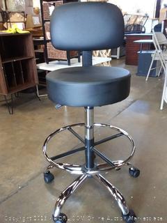 black and aluminum swivel chair