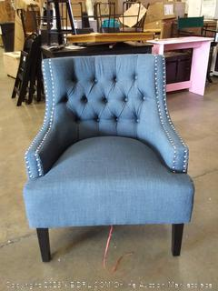 dark blue accent chair with metal buttons