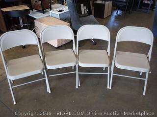 set of gray metal folding chairs