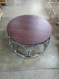 dark wood coffee table with metal bars and wheels