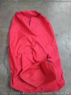 Big red bag with wheels (small tear)