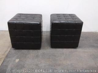 two black leather cubed ottomans