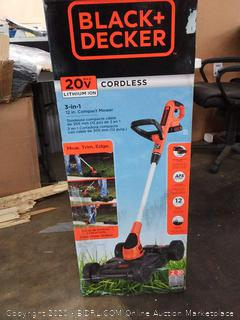 Black & Decker 20 volt lithium ion 3 in one 12 inch compact mower powers on