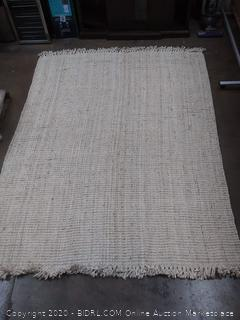 wool woven 7 by 10 ft area rug with tassels