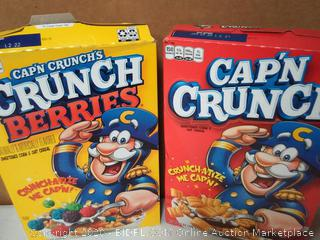 two boxes of Captain Crunch one regular one crunch berries