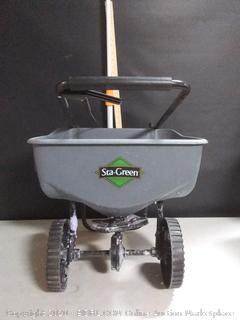 the green Turf Builder spread grass seed