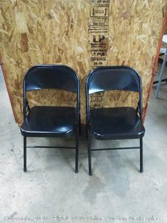 two black metal foldable chairs