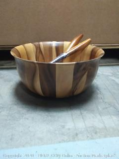 wooden salad bowl with spoons