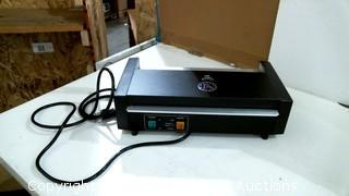 Laminator Powers on Please Preview