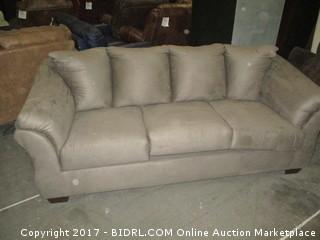 Signature Sofa./  Please Preview MSRP $1000.00 Small damaged at back
