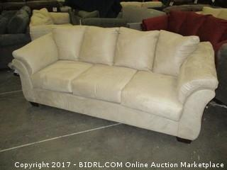 Signature Sofa./  Please Preview MSRP $1000.00 Damage at back corner