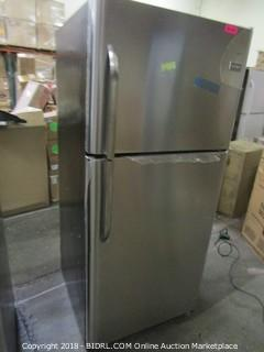 Frigidaire  Refrigerator MSRP* $929 (Powers on and Cools/ Some damage at back)